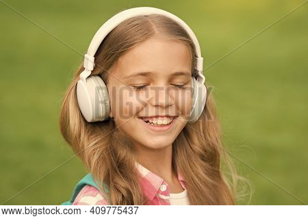 Listen Music While Walking. Girl Headphones Listening Music. Educational Podcast. Kid Girl Enjoy Mus