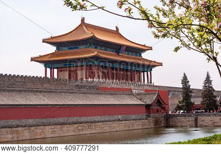 Beijing, China - April 27, 2010: Moat, Ramparts, And Red Gate Of Divine Prowess Building As Exit Of