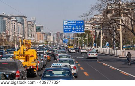 Beijing, China - April 27, 2010: Broad One-way Multi-lane Street With Trucks, Cars, Buses Stuck In T