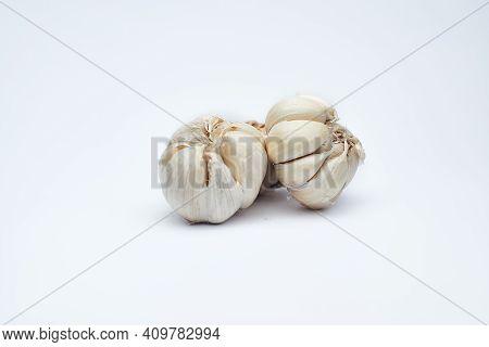 Fresh  Garlic On White Background. Stock Photo