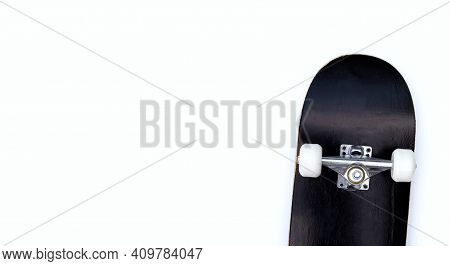 Black Skateboard On A White Background.top View