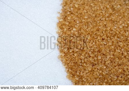 White Granulated Sugar With Brown Sugar. Top View