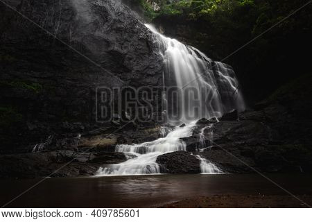 Beautiful Waterfall Landscape - A Long Exposure Of A Waterfall Flowing Down Into A Pool Of Cold Wate