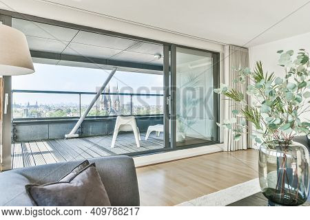 A Spacious Balcony With Glass Door. Modern Apartment With A Large Balcony Space
