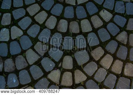 Texture Of Stone Paving Stones. Cobblestone Arched Pavement Road At The Sidewalk. Hard Surface. Ston