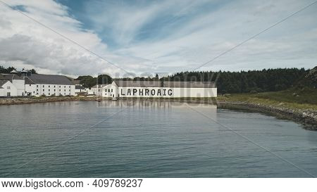 2018.08.07 - Laphroaig distillery, Port Ellen, Islay Island, United Kingdom. Europe whiskey industry. Closeup aerial alcohol industry, Great Britain. Old building at ocean bay. Nobody nature seascape