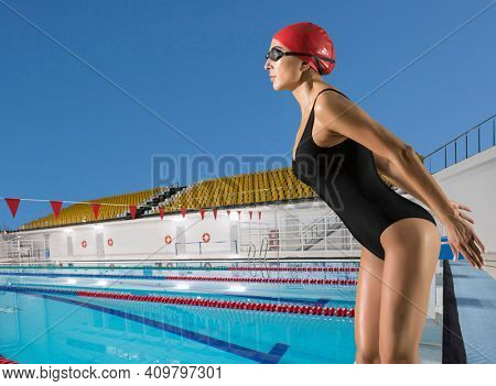 Portrait  professional woman in swimming pool. Sports banner