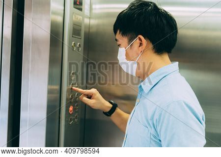 Young Asian Businessman Wearing Protective Face Mask As Precaution Against Coronavirus Standing In E