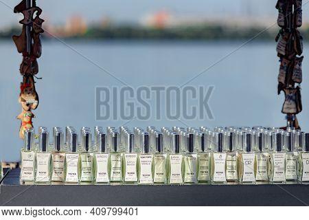 Dnepr, Ukraine- September 12, 2020: Row Of Different Perfume Bottles In Street Beauty Stall, Street