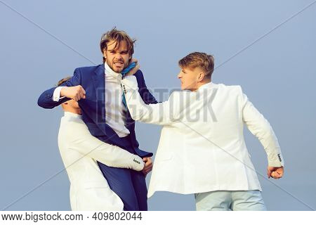 Business People Fighting. Young Men In Business Outfit On Wedding Fight