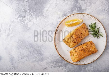 Healthy Salmon Fillet  With Lemon On A Plate. Roasted Salmon. Top View.  Space For Text