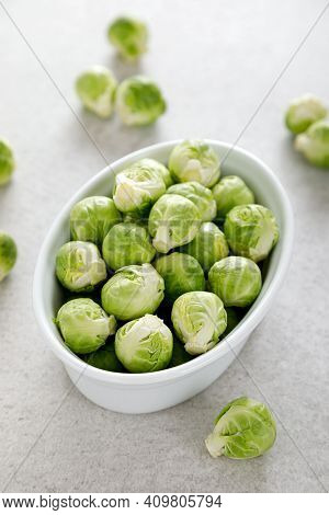 Fresh Green Brussels Sprouts On Cooking Kitchen Table