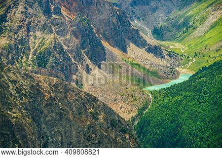 Aerial Spectacular View To Scenic Valley With Beautiful Mountain Lake, Conifer Forest And Rocky Moun