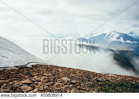 Mountain Snowy Top Above Thick Clouds With View To Giant Mountains And Glaciers. Snow On Mountain Pe