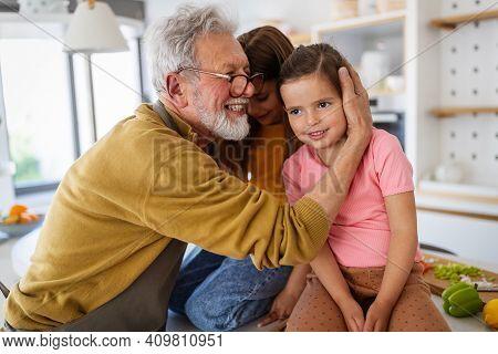 Happy Grandparent Playing, Having Fun With Grandchildren
