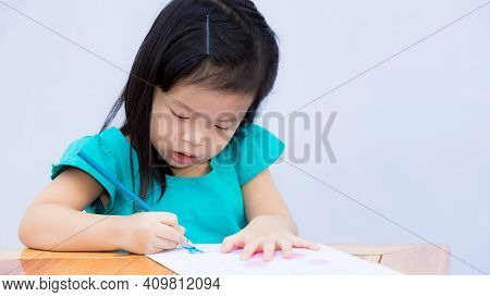 Happy Child With Her Imaginary Artwork. Children Drawing Art And Wood Coloring. Cute Girl Holding Bl