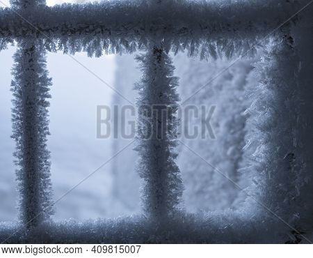Window Grate With Snowflakes And Hoarfrost In Winter