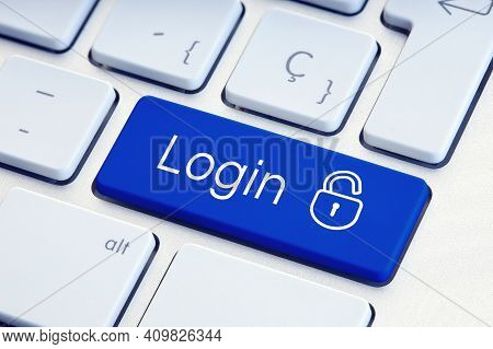 Login Word And Lockpad On Blue Computer Keyboard Key. Technology Security Or Hacking Concept