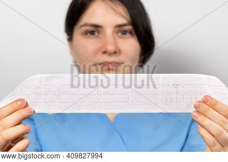 The Cardiologist Shows The Film Of An Electrocardiogram Of A Patient With Acute Myocardial Infarctio