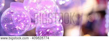 Transparent Christmas Balls With Colored Lights Inside. Decorations For Christmas Concept