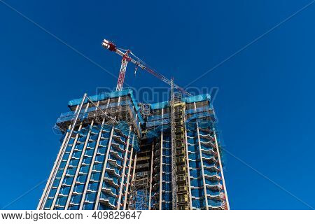 Madrid, Spain - February 14, 2021: Low Angle View Of Colon Towers Under Renovation. Nearly Zero Ener