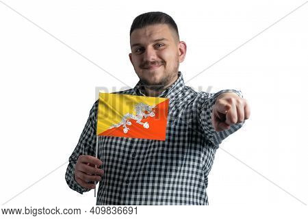 White Guy Holding A Flag Of Butane And Points Forward In Front Of Him Isolated On A White Background