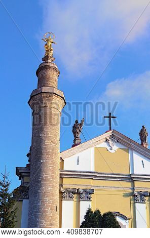 Detailed View The Top Of Ancient Saint Peter And Paul Cathedral. Church With Minaret. Blue Sky In Th