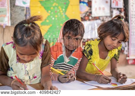 Rajasthan. India. 07-02-2018. Children Are Drawing At School In A Village In The Rajasthan.