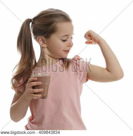 Cute Little Girl With Glass Of Chocolate Milk Showing Her Strength On White Background