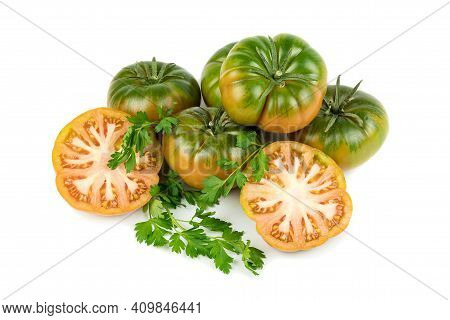 Rare Raf Type Tomatoes, With An Intense Flavor And Peculiar Appearance, Whole And Cut In Half. Isola