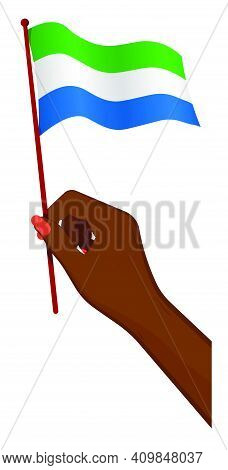 Female Hand Gently Holds Small Flag Of Republic Of Sierra Leone. Holiday Design Element. Cartoon Vec