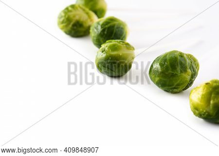 Set Of Brussel Sprouts With Lollipop Sticks On White Background. Copy Space