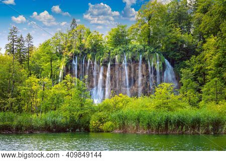 Large panorama of waterfalls in Plitvice Lakes National Park, Croatia, Europe. Majestic view with turquoise water of the lake and waterfalls, tourist attractions