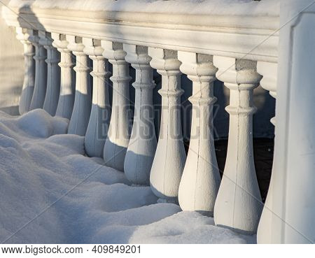 Close-up Of White Classic Balustrade With Snow.
