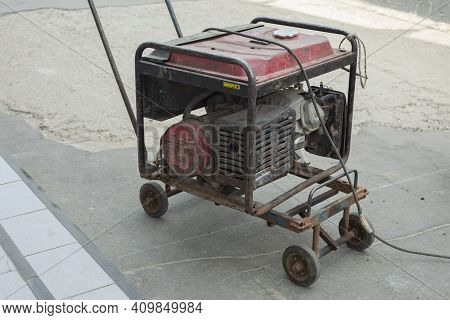 Gasoline Generator On The Street. Generator With Wheels For Transportation. A Source Of Electricity