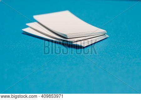 Blank Business Cards On Office Desk Blue Background Pens Mocap