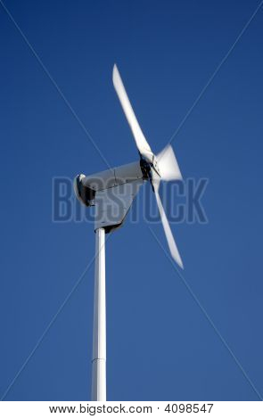 Small Electricity Generating Wind Turbine Spinning With Motion Blur Movement.