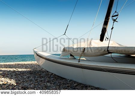 Catamaran On The Beach On The Stones. Horizontal Image.