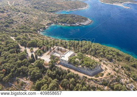 Aerial Drone Shot Of Stone Fort George Croatia On Top Of Hill In Adriatic Sea On Vis Island In Summe