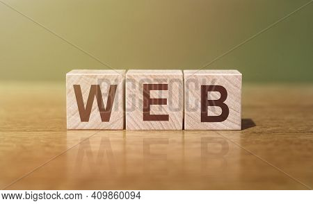 Web Word Written On Wooden Blocks On Wooden Table. Concept For Your Design.
