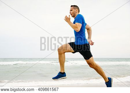 Closeup Male Runner Running In Background Of Sea And Sky