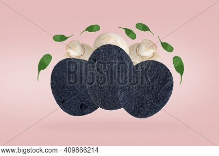 : Potato Chips And Mushrooms In The Air. Black Potato Chips And Fresh Champignons. Champignon-flavor