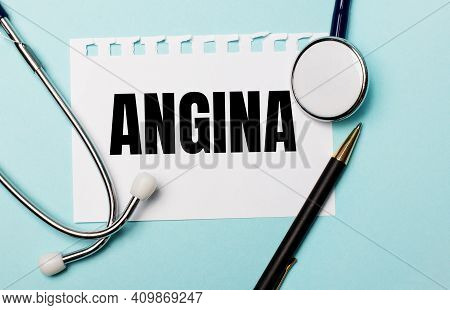 On A Light Blue Background, A Stethoscope, A Pen And A Sheet Of Paper With The Inscription Angina. M