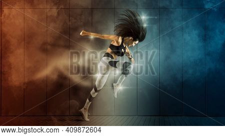 Sporty young woman running on wall background