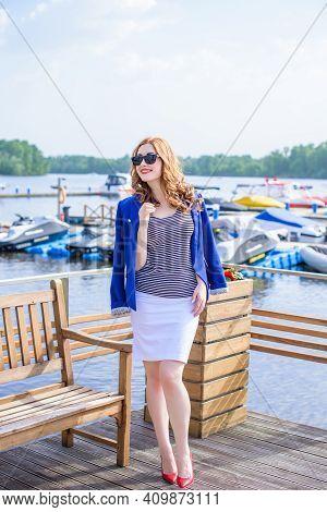 Beautiful Fashionable Woman Enjoying With Marine Vacation In The Yacht Club. Outdoor Fashion Portrai