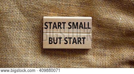 Start Small But Start Symbol. Concept Words 'start Small But Start' On Wooden Blocks On A Beautiful