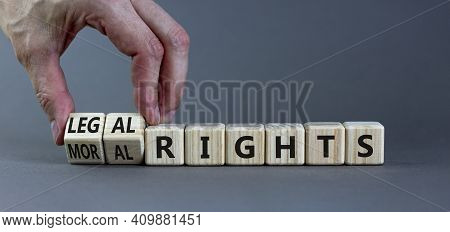Moral Or Legal Rights Symbol. Businessman Turns Wooden Cubes And Changes Words Moral Rights To Legal