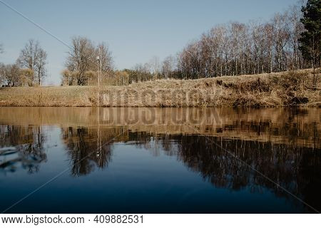 Recreation Camping Area By The Blue Lake In Sunny Summer Day On The Shore Of Water Body With Trees,