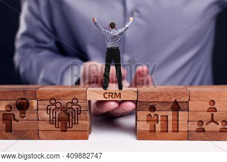 Business, Technology, Internet And Network Concept. Young Businessman Shows The Word:crm