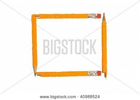 Four yellow sharpened pencils form a square frame.  XXXL